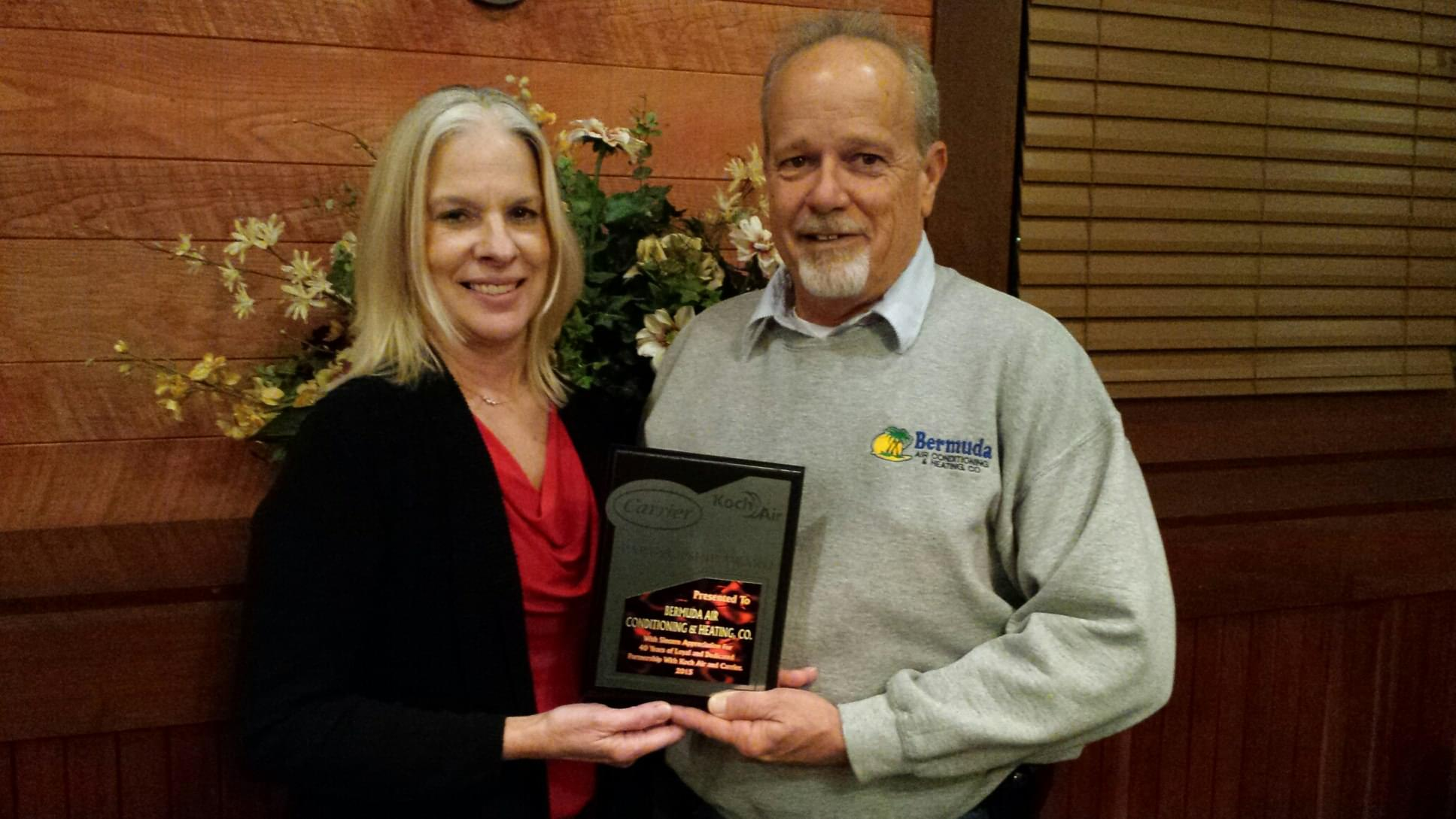 Bermuda Heating & Cooling Accepts 40 Year Carrier Dealer Award